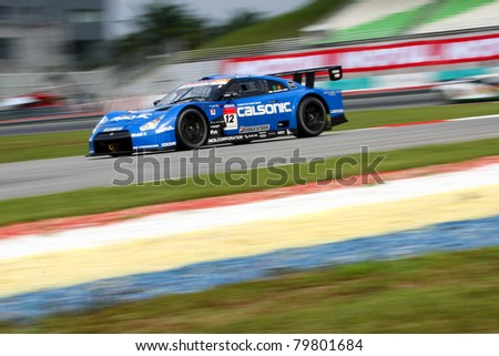 SEPANG - JUNE 18: The Nissan GTR R35 car of Team IMPUL takes to the tracks of the Sepang International Circuit for practice in the Japan SUPER GT Round 3 race on June 18, 2011 in Sepang, Malaysia. - stock photo