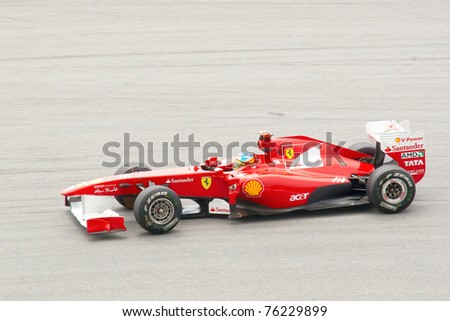 SEPANG, MALAYSIA-APR 8:Ferrari's Fernando Alonso takes to the tracks on practice day at the 2011 Malaysia Formula One Grand Prix on April 8, 2011 in Sepang, Malaysia. - stock photo