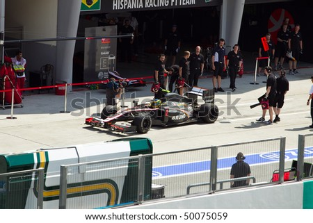 SEPANG, MALAYSIA - APRIL 2: Brazilian Bruno Senna of Team HRT leaving the pit garage at the Petronas Formula 1 Grand Prix April 2, 2010 in Sepang, Malaysia