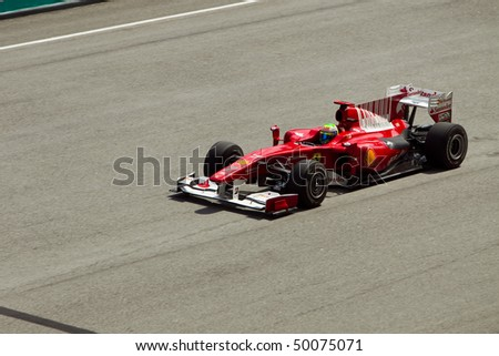 SEPANG, MALAYSIA - APRIL 2: Brazilian Felippe Massa of Team Ferrari accelerating on the main straight at the Petronas Formula 1 Grand Prix April 2, 2010 in Sepang, Malaysia - stock photo