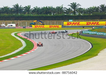 SEPANG, MALAYSIA - APRIL 9: Cars on track at qualification of Formula 1 GP, April 9 2011, Sepang, Malaysia - stock photo