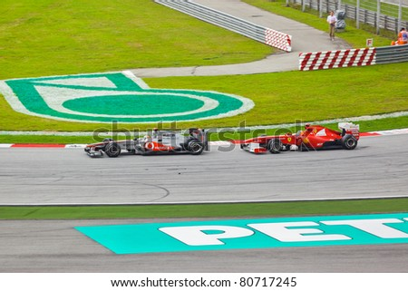 SEPANG, MALAYSIA - APRIL 10: Cars on track at race of Formula 1 GP, April 10 2011, Sepang, Malaysia - stock photo