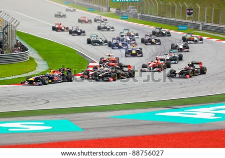 SEPANG, MALAYSIA - APRIL 10: Cars on track at race of Formula 1 GP, April 10 2011, Sepang, Malaysia. First lap. - stock photo