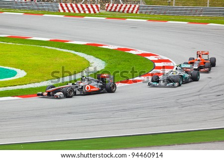 SEPANG, MALAYSIA - APRIL 10: Cars on track at race of Formula 1 GP, April 10, 2011, Sepang, Malaysia - stock photo
