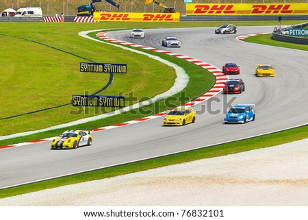 SEPANG, MALAYSIA - APRIL 9: Cars on track at race of Malaysian Super Series, April 9, 2011 in Sepang, Malaysia. - stock photo