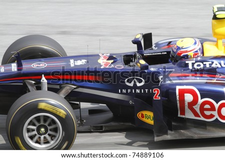 SEPANG, MALAYSIA - APRIL 8: Close-up of Mark Webber of Red Bull Racing at PETRONAS Malaysian Grand Prix on April 8, 2011 in Sepang, Malaysia. The race will be held on Sunday April 10, 2011. - stock photo