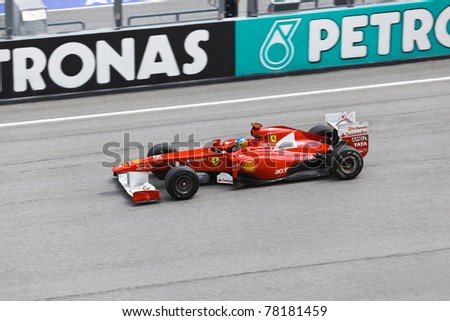 SEPANG, MALAYSIA - APRIL 8: Fernando Alonso (team Scuderia Ferrari Marlboro) at first practice  at the Formula 1 GP on April 8 2011 in Sepang, Malaysia - stock photo