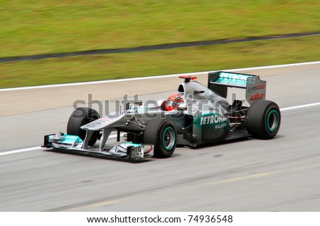 SEPANG, MALAYSIA - APRIL 8: German Michael Schumacher of Mercedes GP at the back straight during Friday practice at Petronas Formula 1 Grand Prix on April 8, 2011 in Sepang, Malaysia - stock photo