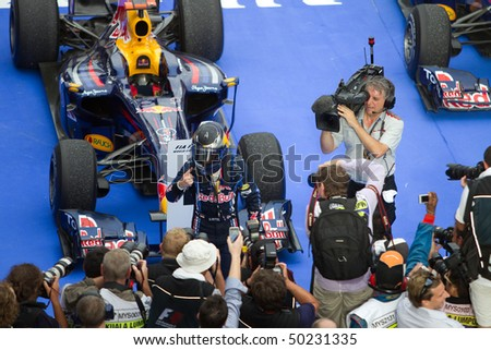 SEPANG, MALAYSIA - APRIL 4: German Sebastian Vettel of Team Red Bull celebrates after winning the race at the Petronas Formula 1 Grand Prix April 4, 2010 in Sepang, Malaysia - stock photo