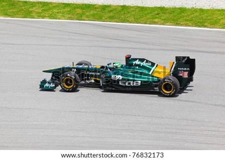 SEPANG, MALAYSIA - APRIL 8: Heikki Kovalainen (team Lotus) at first practice on Formula 1 GP, April 8, 2011 in Sepang, Malaysia. - stock photo