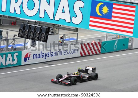 SEPANG, MALAYSIA - APRIL 4 : Hispania Racing F1 driver Bruno Senna of Brazil drives during Petronas Malaysian Grand Prix  at Sepang F1 circuit April 4, 2010 in Sepang, Malaysia - stock photo