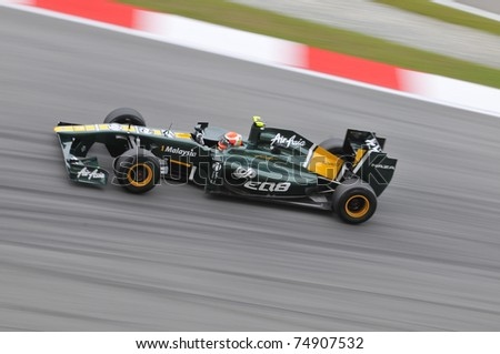 SEPANG, MALAYSIA - APRIL 8: Jarno Trulli of Team Lotus during practice session at PETRONAS Malaysian GP on April 8, 2011 in Sepang, Malaysia. The race will be held on April 10, 2011 - stock photo