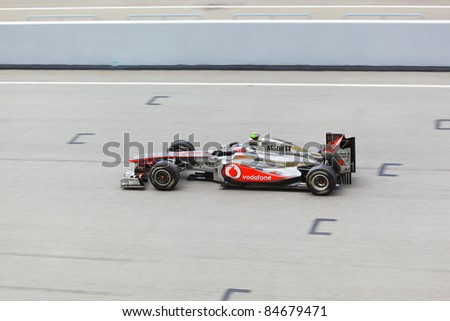 SEPANG, MALAYSIA - APRIL 8: Jenson Button (team McLaren Mercedes) at first practice on Formula 1 GP, April 8 2011, Sepang, Malaysia - stock photo