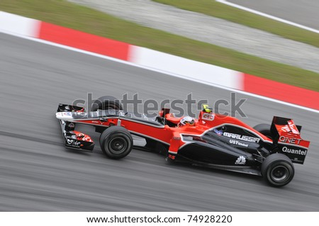 SEPANG, MALAYSIA - APRIL 8: Jerome d'Ambrosio of Virgin Racing during practice session at PETRONAS Malaysian GP on April 8, 2011 in Sepang, Malaysia. The race will be held on April 10 - stock photo