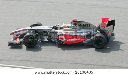 SEPANG, MALAYSIA - APRIL 3 : Lewis Hamilton of Vodafone McLaren Mercedes brakes hard during practice session at Malaysian F1 Grand Prix April 3, 2009 at Sepang International Circuit in Sepang. - stock photo