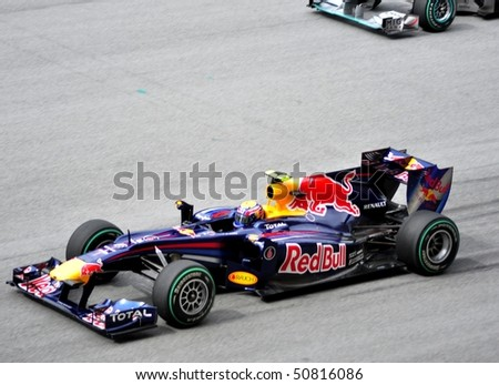 SEPANG, MALAYSIA - APRIL 4: Mark Webber of Red Bull Racing Team getting ready during Malaysian Formula 1 Grand Prix April 4, 2010 in Sepang, Malaysia. - stock photo