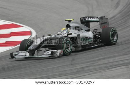 SEPANG, MALAYSIA - APRIL 2 : Mercedes Formula One driver Nico Rosberg of Germany drives during Petronas Malaysian Grand Prix second practice session at Sepang F1 circuit April 2, 2010 in Sepang - stock photo