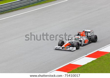 SEPANG, MALAYSIA - APRIL 8: Narain Karthikeyan (team Hispania Racing) at first practice on Formula 1 GP, April 8 2011, Sepang, Malaysia - stock photo