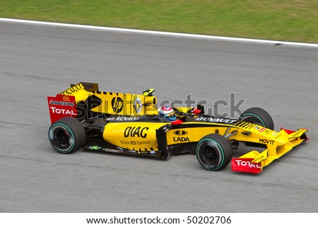 SEPANG, MALAYSIA - APRIL 4: Russian Vitaly Petrov of Team Renault at top speed on the main straight at the Petronas Formula 1 Grand Prix April 4, 2010 in Sepang, Malaysia - stock photo