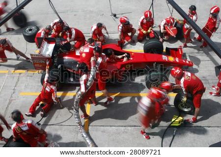 SEPANG, MALAYSIA - APRIL 4: Scuderia Ferrari Marlboro crews do pit-stop practice at the 2009 F1 Petronas Malaysian Grand Prix April 4, 2009 in Sepang Malaysia. - stock photo