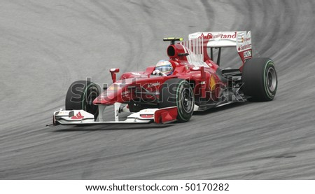 SEPANG, MALAYSIA - APRIL 2 : Scuderia Ferrari Marlboro driver Fernando Alonso of Spain drives during Petronas Malaysian Grand Prix second practice session at Sepang F1 circuit April 2, 2010 in Sepang - stock photo