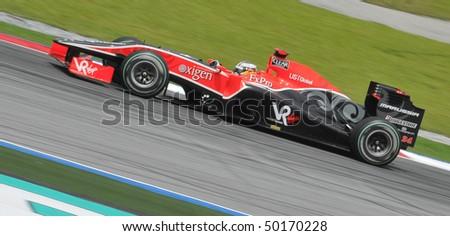 SEPANG, MALAYSIA - APRIL 2 : Scuderia Toro Rosso driver Timo Glock of German drives during Petronas Malaysian Grand Prix second practice session at Sepang F1 circuit April 2, 2010 in Sepang - stock photo