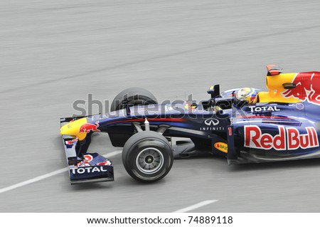 SEPANG, MALAYSIA- APRIL 8: Sebastian Vettel of Red Bull Racing in action at PETRONAS Malaysian Grand Prix on April 8, 2011 in Sepang, Malaysia. The race will be held on Sunday April 10, 2011. - stock photo
