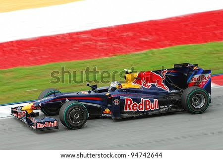 SEPANG, MALAYSIA - APRIL 5: Sebastian Vettel of Red Bull Racing in action at PETRONAS Malaysian Grand Prix on April 5, 2009 in Sepang, Malaysia - stock photo