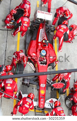 SEPANG, MALAYSIA - APRIL 4: Spanish Fernando Alonso of Team Ferrari pitting for tires at the Petronas Formula 1 Grand Prix April 4, 2010 in Sepang, Malaysia - stock photo