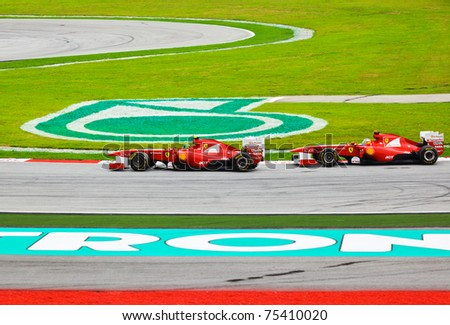 SEPANG, MALAYSIA - APRIL 10:  Unidentified Ferrari drivers on track at the Formula 1 GP on April 10 2011 in  Sepang, Malaysia - stock photo