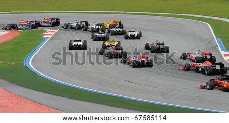 SEPANG, MALAYSIA - APRIL 4 : View of racing cars few second after start in Petronas Formula One 2010 at Sepang circuit. April 4, 2010 in Sepang, Malaysia - stock photo