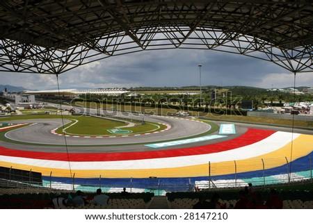 Sepang, MALAYSIA - 4 April: View of the tracks and grandstand of the Sepang International Circuit during the  2009 F1 Petronas Malaysian Grand Prix.  4 April 2009 in Sepang, Malaysia. - stock photo