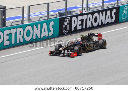 SEPANG, MALAYSIA - APRIL 8: Vitaly Petrov (team Lotus Renault) at first practice on Formula 1 GP, April 8 2011, Sepang, Malaysia - stock photo