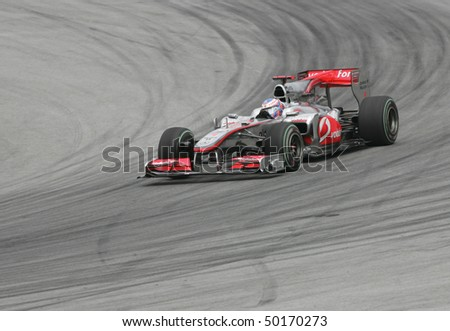 SEPANG, MALAYSIA -APRIL 2:Vodafone McLaren Mercedes driver Jenson Button of Great Britain drives during Petronas Malaysian Grand Prix 2nd practice session at Sepang F1 circuit April 2, 2010 in Sepang