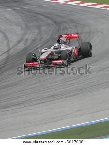 SEPANG, MALAYSIA -APRIL 2:Vodafone McLaren Mercedes driver Jenson Button of Great Britain drives during Petronas Malaysian Grand Prix 2nd practice session at Sepang F1 circuit April 2, 2010 in Sepang - stock photo