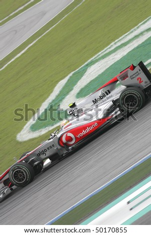 SEPANG, MALAYSIA -APRIL 2:Vodafone McLaren Mercedes driver Lewis Hamilton of Great Britain drives during Petronas Malaysian Grand Prix 2nd practice session at Sepang F1 circuit April 2, 2010 in Sepang - stock photo