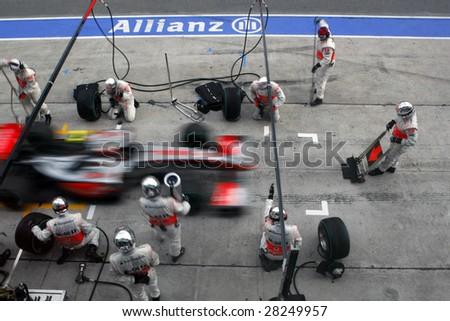 SEPANG, MALAYSIA - APRIL 5: Vodafone McLaren Mercedes pit-stop at the final race of the 2009 F1 Petronas Malaysian Grand Prix. April 5, 2009 in Sepang Malaysia. - stock photo