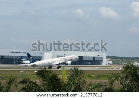 SEPANG, MALAYSIA - AUGT 4: Boeing 777-368(ER) registered with number HZ-AK13 owned by Saudi Arabian take off at Kuala Lumpur International Air Port, Sepang, Malaysia on August 4, 2014.