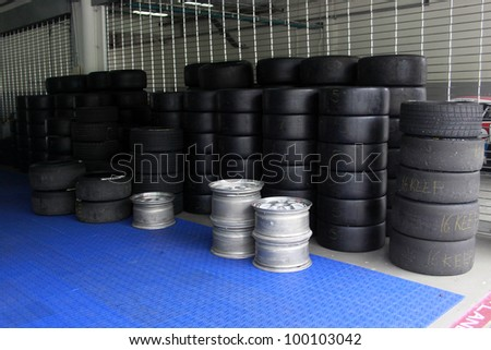 SEPANG, MALAYSIA - DECEMBER 5: Stack of tires placed in the garage during the MHH Super Series Round 5 on December 5, 2009 in Sepang, Malaysia - stock photo