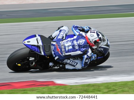 SEPANG, MALAYSIA-FEB 24: Ben Spies of Yamaha Factory Racing at MotoGP Official Test Sepang 2 on Feb 24, 2011 in Sepang, Malaysia. - stock photo