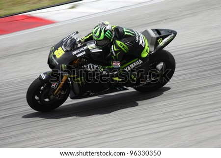 SEPANG, MALAYSIA - FEB 28 - Cal Crutchlow (Great Britain) from the Monster Yamaha Tech 3 during the  second Official MotoGP test of the 2012 season on Feb 28,1012 in Sepang, Malaysia - stock photo