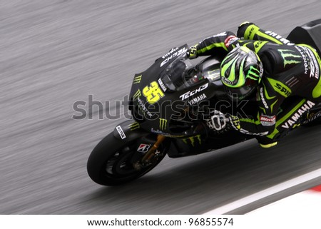 SEPANG,MALAYSIA-FEB 29: Cal Crutchlow of Monster Yamaha Tech 3 at 2012 MotoGP Official Winter Test Sepang 2 on Feb 29, 2012 in Sepang, Malaysia.The 2012 MotoGP season starts on April 8 in Qatar.