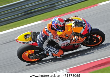 SEPANG, MALAYSIA-FEB 24: Casey Stoner of Repsol Honda Team takes a corner at MotoGP Official Test Sepang 2 on Feb 24, 2011 in Sepang, Malaysia. - stock photo