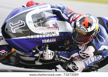 SEPANG, MALAYSIA-FEB 24: Jorge Lorenzo of Yamaha Factory Racing takes a lap at MotoGP Official Test Sepang 2 on Feb 24, 2011 in Sepang, Malaysia. - stock photo