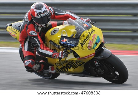 SEPANG, MALAYSIA - FEB. 25 : Paginas Amarillas Aspar rider Hector Barbera of Spain takes a corner during the 2010 pre-season test at Sepang circuit February 25, 2010 in Sepang, Malaysia.
