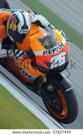 SEPANG, MALAYSIA - FEB. 26: Repsol Honda rider Dani Pedrosa of Spain during the 2010 pre-season test at Sepang circuit February 26, 2010 in Sepang, Malaysia. - stock photo