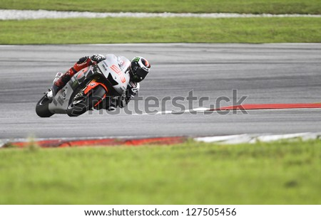 SEPANG, MALAYSIA-FEB 7: Spain No. 99 Jorge Lorenzo of Yamaha Factory Racing at MotoGP Official Test Sepang 1 on Feb 7, 2013 in Sepang, Malaysia. Season 2013 will start in Qatar on April 7. - stock photo