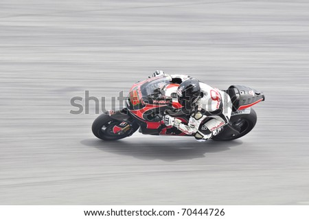SEPANG, MALAYSIA - FEBRUARY 3: Loris Capirossi from Pramac Racing Team during MotoGP Pre-Season Test Day 3 on February 3, 2011 at Sepang International Circuit, Malaysia - stock photo