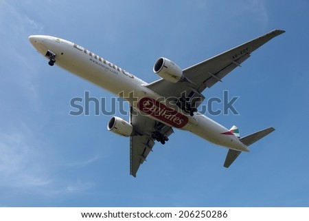 SEPANG, MALAYSIA - JULY 19: Emirates plane, Boeing 777-31H(ER), Registration name A6-ECY, ready to landing at KLIA airport on July 19, 2014 in KLIA, Sepang, Malaysia.  - stock photo