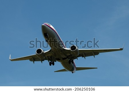 SEPANG, MALAYSIA - JULY 19: Malaysia Airlines plane Boeing 737-8FZ, Registration name 9M-FFF, ready to landing at KLIA airport on July 19, 2014 in KLIA, Sepang, Malaysia.  - stock photo